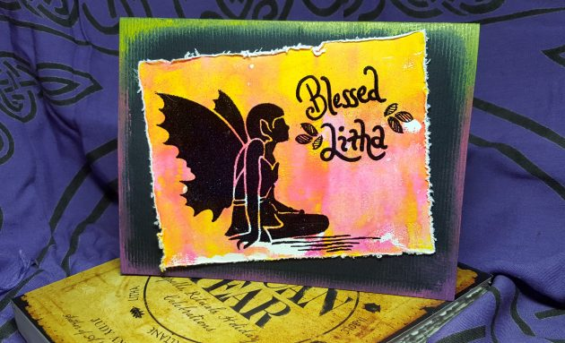 "Alisaon Heikkila finished summer solstice card featuring a stenciled and embossed fairy and sentiment ""blessed Litha"" in radiant neon colors with black frame and embossing."
