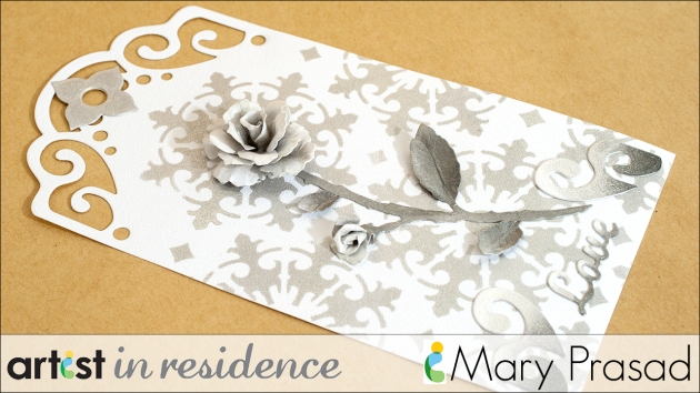 Shimmery tag made with Delicata Inks featuring a three dimensional Rose made by Mary Prasad.