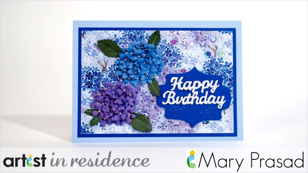 Mary Prasad's finished hydrangea card using VersaMarker to emboss certain parts of a print paper in blues and purples