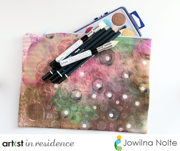 Graffiti styled pencil pouch or art bag with paints and pencils. Colored with fabric inks such as Memento Luxe and All-Purpose Inks in pinks, browns, greens and white.