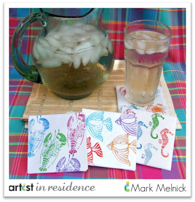 Colorful handmade beach themed coasters with lobsters, tropical fish, seahorses and crabs displayed with a pitcher and glass of sun tea.