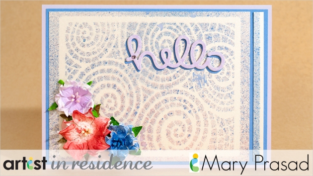 A speckled mosaic swril background is highlighted in this card which also features colored craft flowers and a purple hello die cut in this handmade card by Mary Prasad.