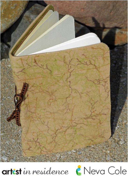 A handmade mini journal using fun foam, StazOn inks, ribbon and cardstock by Neva Cole.