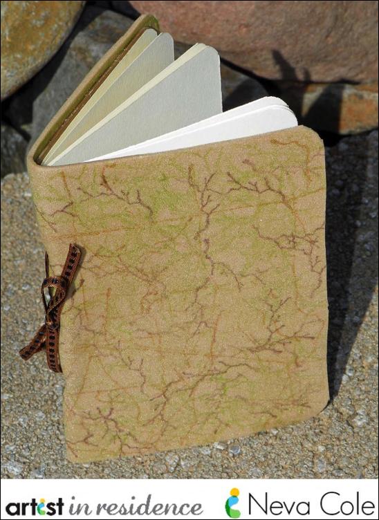 A handmade mini journal using fun foam, StazOn inks, ribbon and cardstock by Neva Cole.