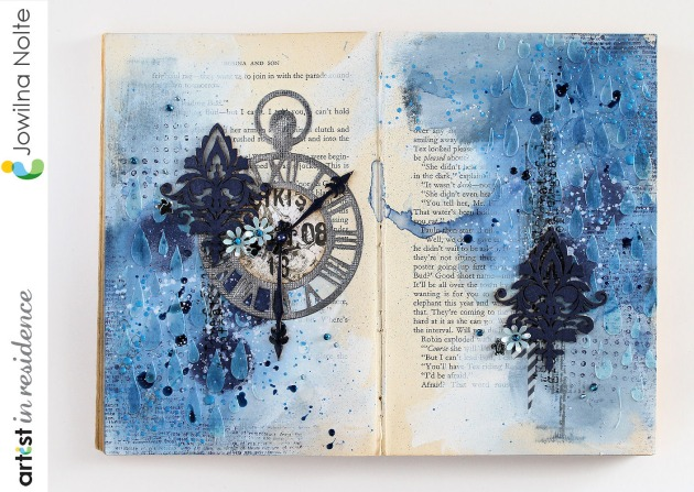 Art journal page made out of an old book using monochromatic Imagine products to create a study in blue by Jowilna Nolte.