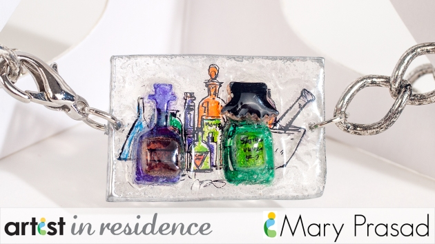 A faux glass charm in bracelet made with Shrinky Dinks and StazOn inks with a Halloween poison bottle design.