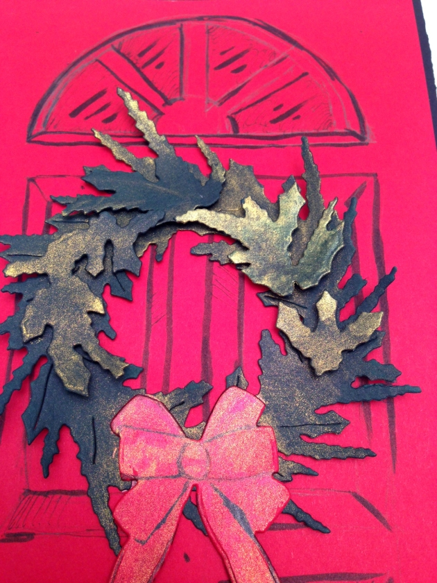 A gold tinted paper wreath on a red paper door made with All-Purpose Inks.