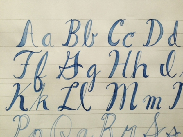 Lettering sample where the thick lines have been over emphasized by coloring in hand calligraphied letters.