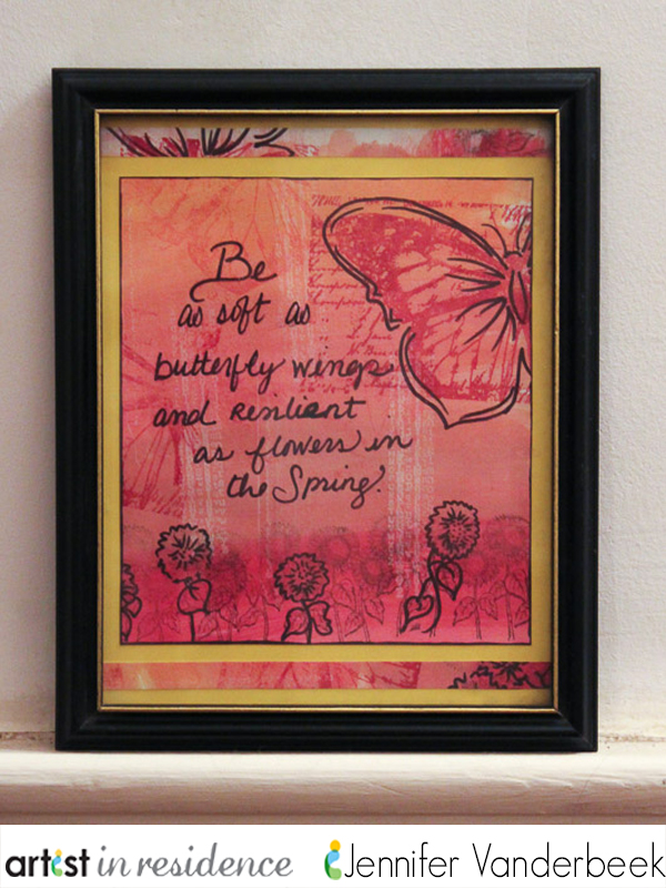 A framed art journal page with a butterfly and flower images in oranges and reds by Jennifer Vanderbeek.