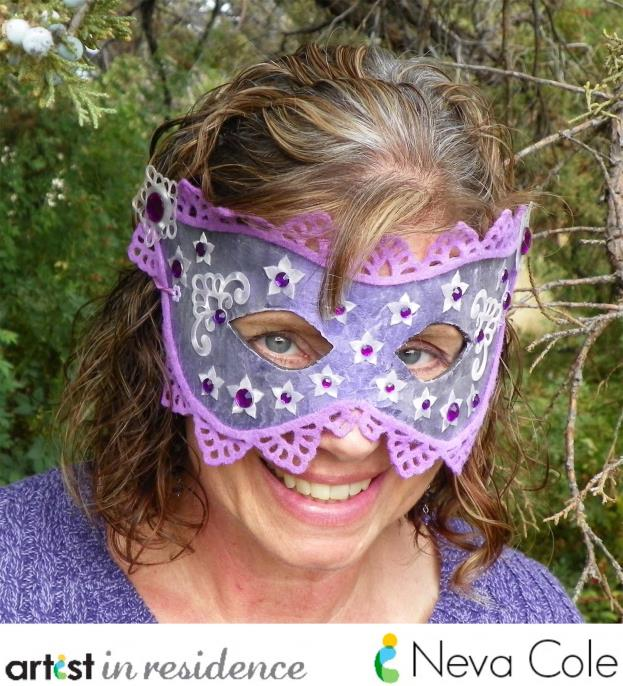 Purple lacy masquerade mask made and modeled by Neva Cole.