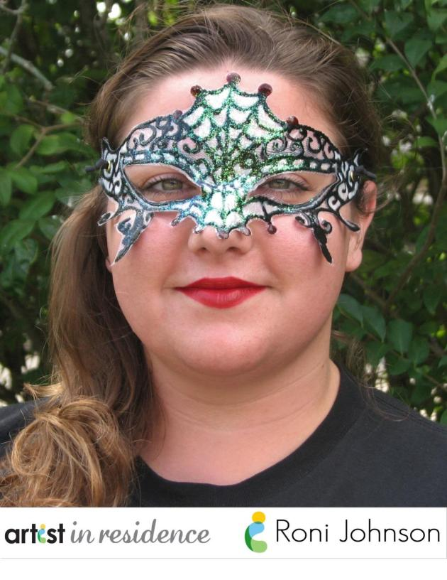 A masquerade ball mask in a spider web motif made with tulle fabric and StazOn Studio Glaze by Roni Johnson is modeled by a smiling young woman with red lipstick.