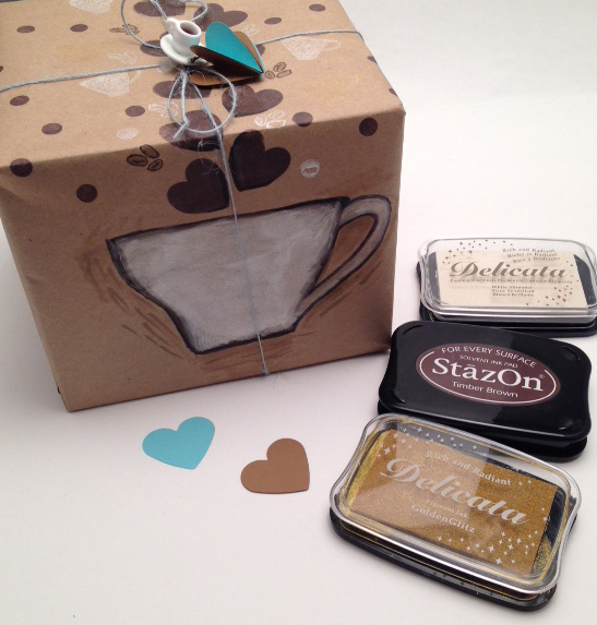 Handmade coffee themed giftwrap with the Delicata and StazOn inks used to make it.
