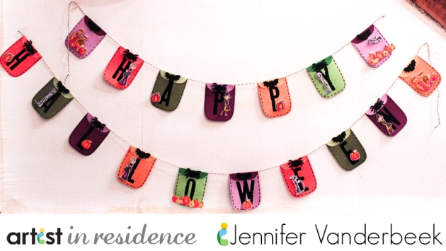 Multicolored Happy Halloween mini garland made with VersaMark and Imagine Black Embossing Powder by Jennifer Vanderbeek.