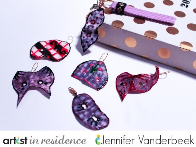 Miniature charms in the shape of masks by Jennifer Vanderbeek.