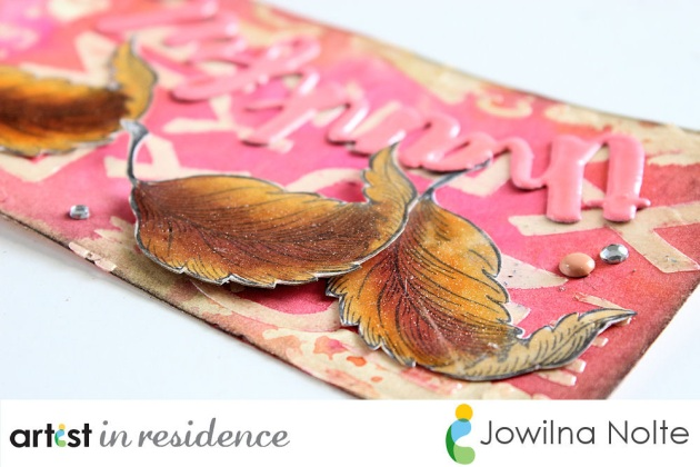 Hand colored fall leaves using Memento Dual Tip Markers adorn a tag featuring the sentiment Thankful by Jowilna Nolte