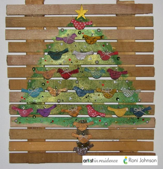 Handmade advent calendar made using Hand-cut Monterey Pine birds and old paellet board by Roni Johnson.