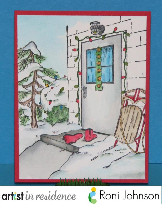 Handmade card featuring a watercolored image of red boots on the stoop of a home decorated with holiday lights, snow all around and a sled left next to the door by Roni Johnson.