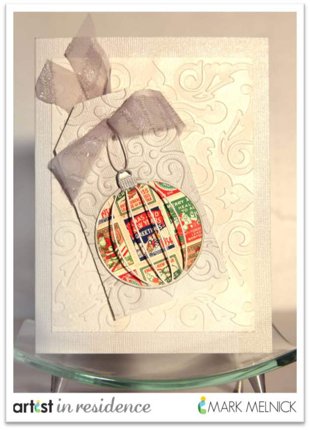 A hnadmade white on white holiday card featuring delicata inks, and an ornamant die cut with color by Mark Melnick.