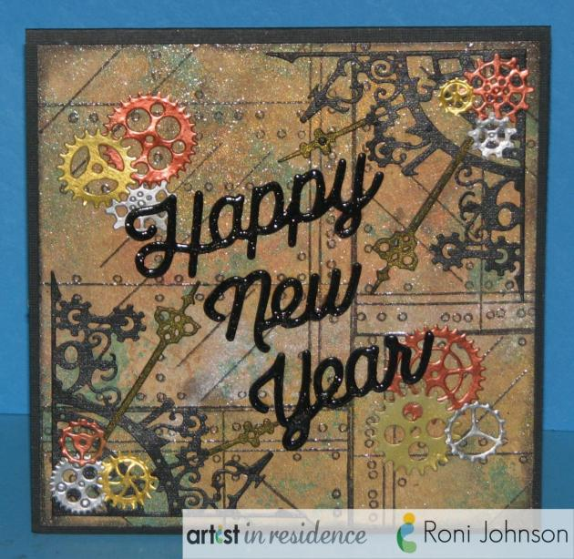 A handmade happy new years card featuring many metallic products from Imagine including Creative Medium and Tsukineko's Delicata inks by Roni Johnson.