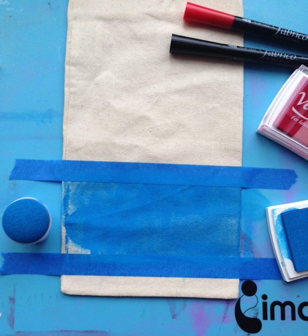 A muslin bag masked with painters tape has been inked with VersaCraft ink in Ultramarine