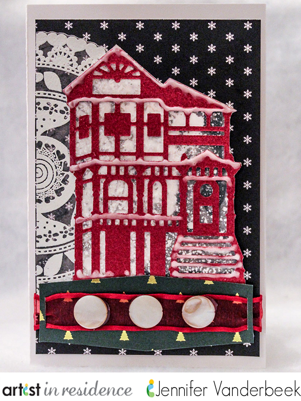 A snowflecked red glittern Victorian house adorns this sweet handmade card by Jennifer Vanderbeek.