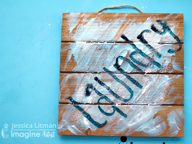 Laundry sign on wood palette with Creative Medium, All Purpose Ink and Sheer Shimmer Spritz.