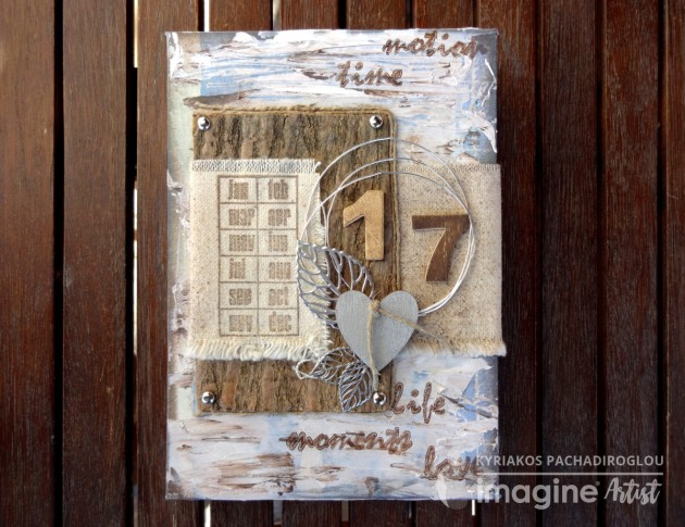 Imagine Artist Kyriakos Pachadiroglou creates a 12 month photo journal for collecting keepsakes throughout the year in 2017. Using VersaColor - Celadon, Pinecone, Encore- Silver, VersaMark, Imagine Embossing Powder - Silver.