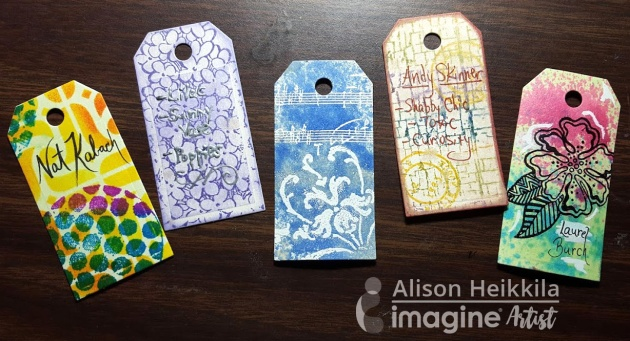 Alison Heikkila creates organizing tags for her stamp collection. Fireworks craft spray. yellow, blue, purple.
