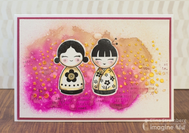 Elina Stromberg creates a great mixed media background. StazOn is used to create a true black ink stamp with cute doll figures.
