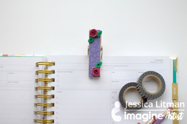Jessica Litman creates mini paper flowers on a clothespin for a planner.