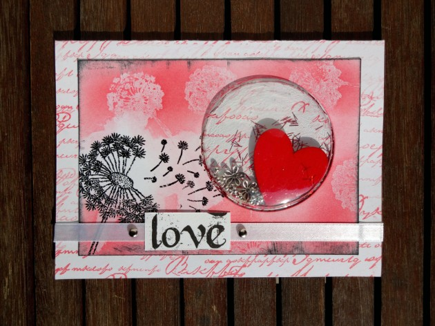 Kyriakos Pachadiroglou shaker card using Memento Lady Bug, Tuxedo Black, VersaMark, and black embossing powder.
