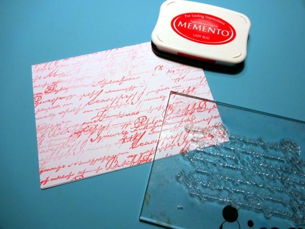 Kyriakos Pachadiroglou shaker card using Memento Lady Bug, Tuxedo Black, VersaMark, and black embossing powder.