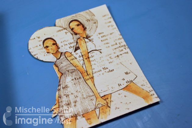 Two ladies stamped image on book page