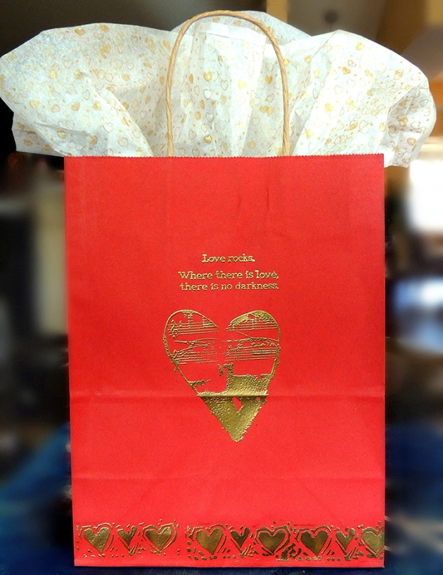Imagine Gold Embossing Powder on a red gift bag for Valentine's Day.