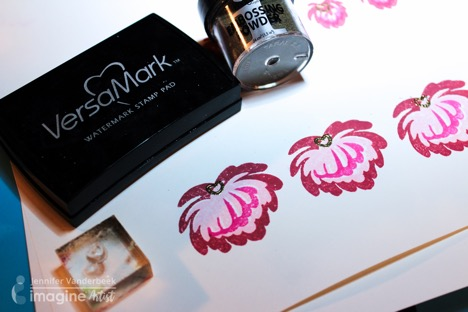 Jennifer Vanderbeek merges papercrafting and jewelry making by using Tsukineko ink and Imagine embossing powder.