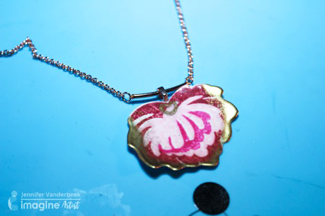 Jennifer Vanderbeek merges papercrafting and jewelry making by using Tsukineko ink and Imagine embossing powder.