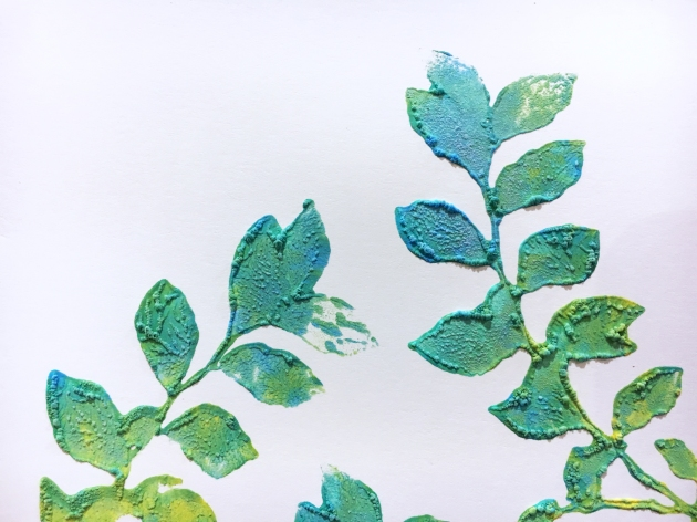Colorful leaf pattern stamped with Amplify! in Radiant Neon in yellow, green and blue with a raised texture using a heat tool by Kazuko Kocho.
