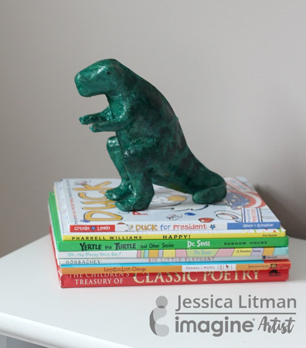 Jessica Litman creates a cute kid's craft project. T Rex Dinosaur with Creative Medium Shimmer and Tsukineko's Memento Tuxedo Black.
