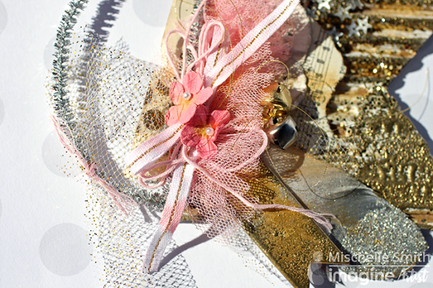 Michelle Smith uses Fireworks, VersaMark and Gold Embossing Powder to make a beautiful glitter banner with pink flowers, feathers, and paper doily. stars, glitter, sparkle, ink, crafts.