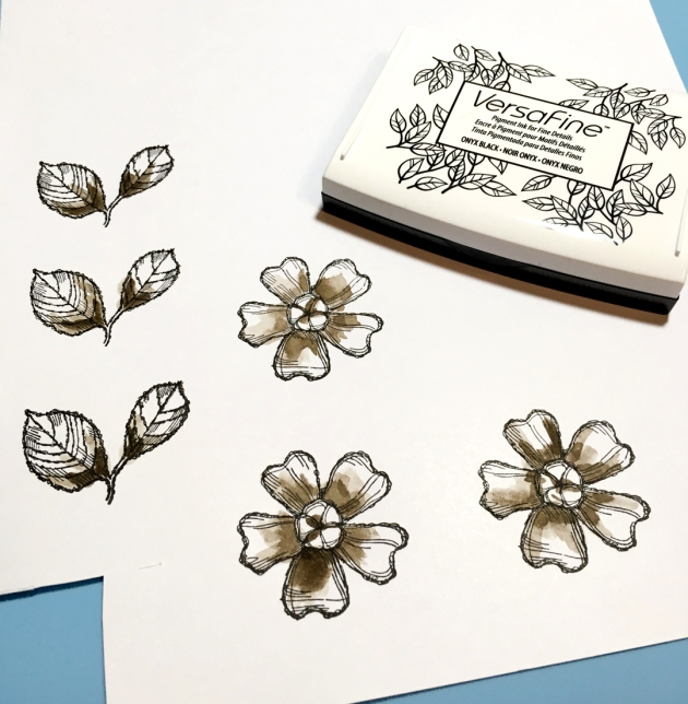 VersaFine and walnut ink used to create flowers and leaves for a papercraft project.