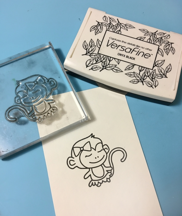 Stamp the cute little monkey on watercolor paper with Onyx Black VersaFine ink.