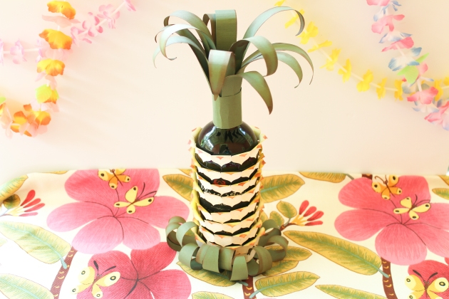 Watch a Video on How to Make a Pineapple Wine Bottle Wrap