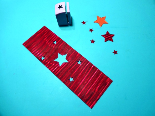 Die cut a star in the center of the Vertigo cutting and punch little stars on the rest of it.