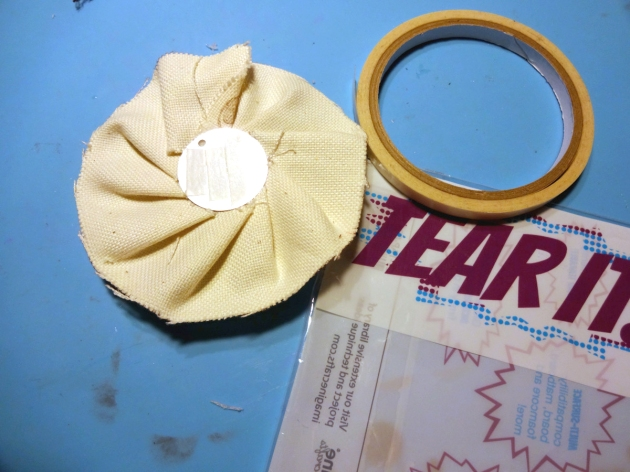 Place cuttings of the Tear It Tape (double-sided tape) at the back side of the metal circles to easily attach to projects.