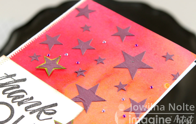 Add a stamped sentiment, additional cut out stenciled stars and some scattered diamanté.