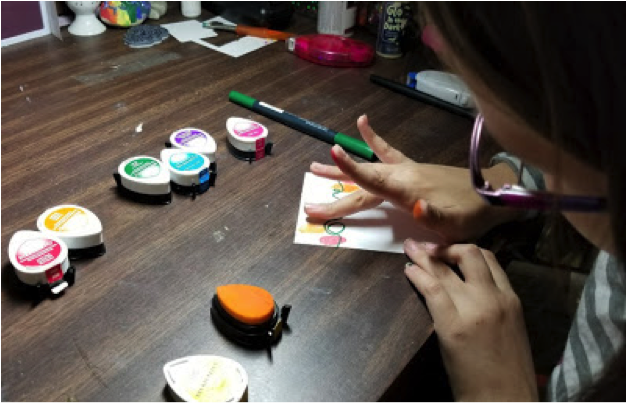kids crafts different colors for the finger print style crafting.