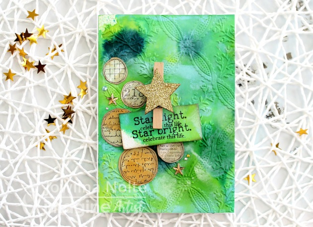 Star Bright Celebrate This Life Holiday Card by Jowilna Nolte. This beautiful Christmas Card celebrates with a bright gold star and a green background.