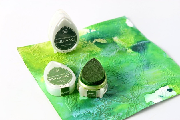 Use Brilliance DewDrops in Pearlescent Ivy to lightly ink over the embossed areas