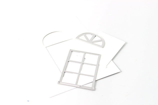 Window shaped thin metal die and cardstock.