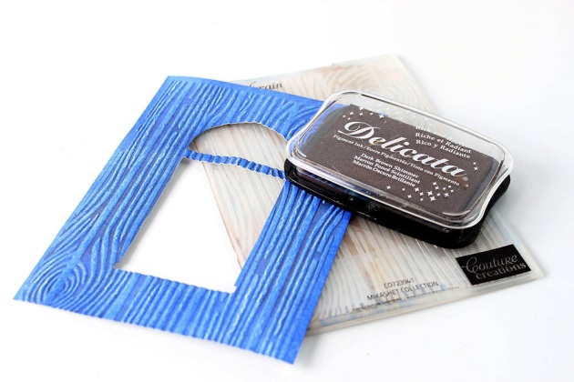 Wood grain embossed card panel using Delicata Blue Sapphire and Delicata Dark Brown Shimmer ink pads.